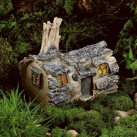 solar powered garden fairy log house led outdoor light