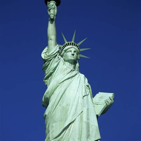 lade liberty walking up the statue of liberty usa today