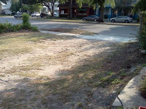 how do i improve the drainage of this grass driveway