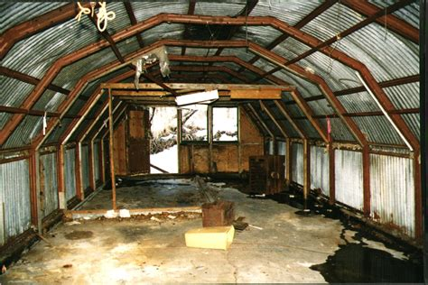 support   wooden quonset farm building