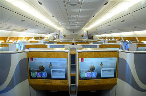 emirates upgrade to business class qantas frequent flyer vs emirates skywards comparing