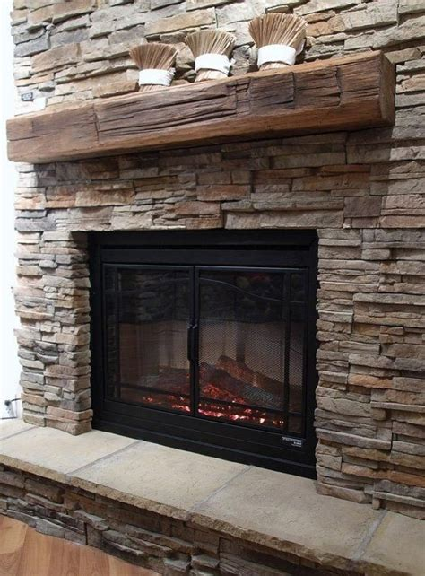 reclaimed wood and stone fireplace wall these one of a kind reclaimed wood mantels are treated and