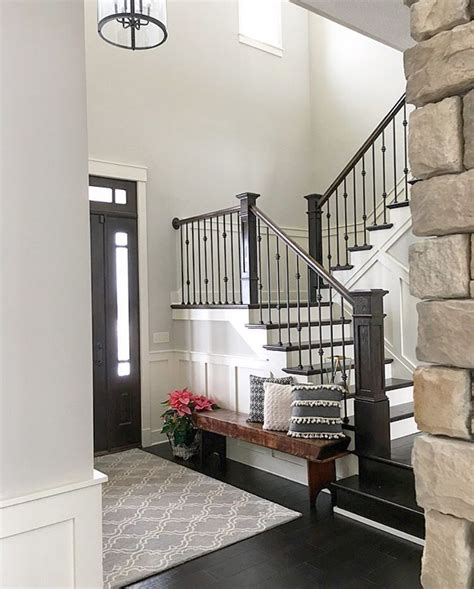 foyer stairs neutral modern farmhouse foyer with wainscoting stained