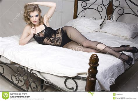 laying on my bed crying woman laying in bed stock photo image of open