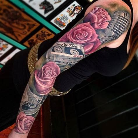 roses full arm sleeve tattoo by joe carpenter