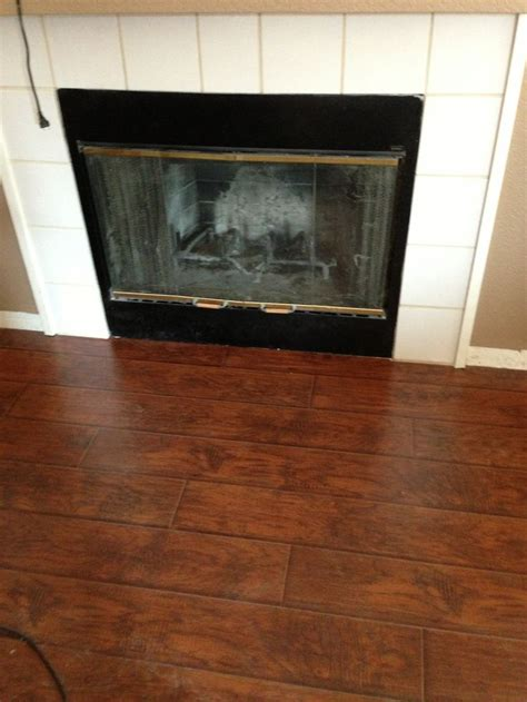 tile out flooring in front of fireplace for the home