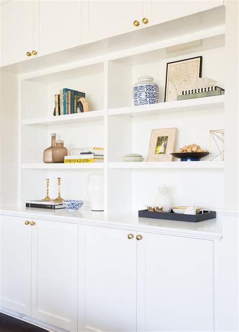 living room built cabinets brass octagon knobs transitional living room
