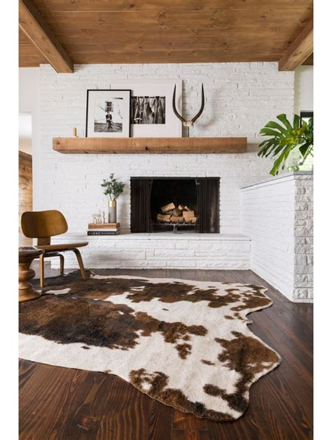 rooms with cowhide rugs best 20 faux cowhide rug ideas on cow rug cow skin rug and ikea leather chair