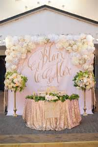 sweetheart table backdrop with large gold calligraphy