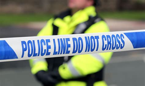 police tape man shot dead in manchester while confronting robbers uk