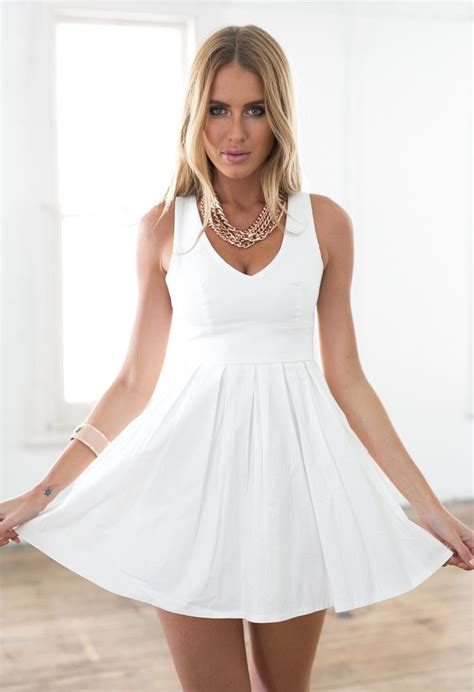 Mini Bow Back Dress white sleeveless mini dress with open cross bow back by