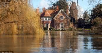 goring george michael the flooded river thames laps at the door to george