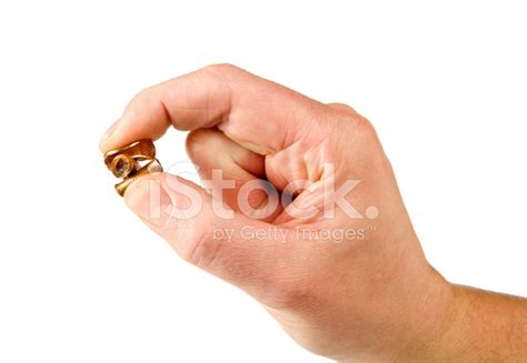 male pennies images male fingers pinching three pennies stock photos