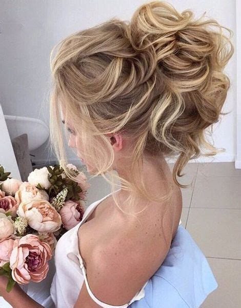 wedding hair messy bun view from front beautiful loose high bun wedding hairstyles 2017