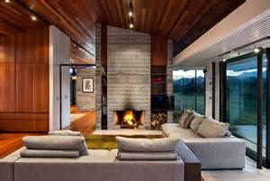 Outdoors Fireplace - modern ranch style home with land loving layout and materials