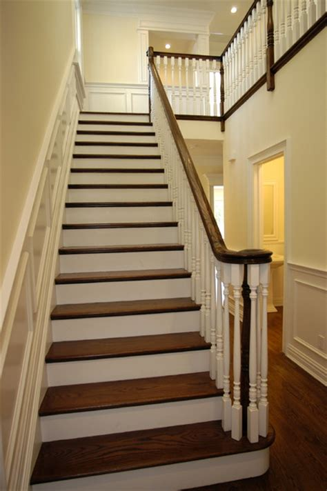 traditional staircases stairs and railing and foyer by heartwood corp