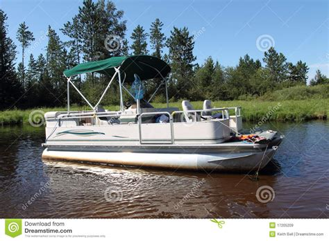 big pontoon boats a big pontoon boat anchored in the river stock image