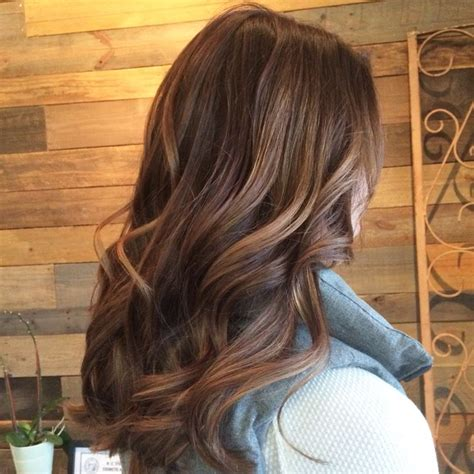 brown hair with the red tent to it and blonde highlights caramel balayage brown hair color hair painting hair by