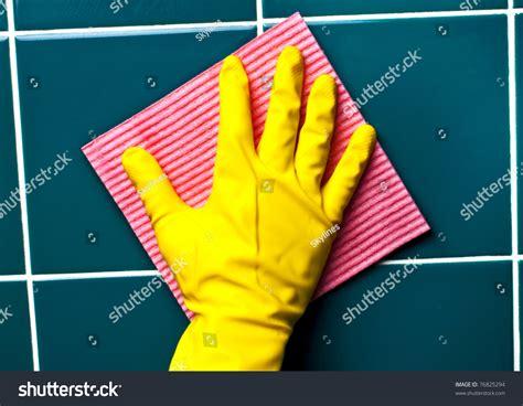 amazing of stock photo hand with sponge cleaning bathroom hand yellow sponge cleaning bathroom tiles stock photo