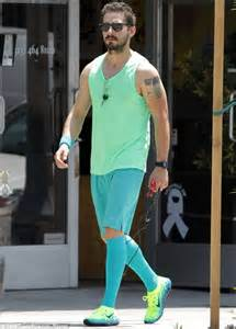 shia labeouf wears lurid green as he goes skipping
