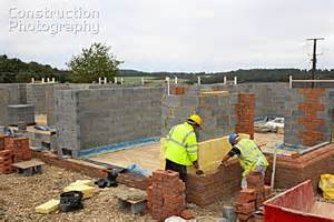 House Site A026 00974 Bricklayers On A House Building Site Englan