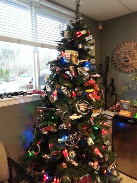 christmas tree decorated with tons of car logos has