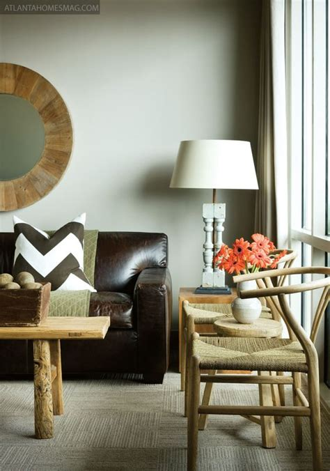 rough on couch smooth dark brown leather couch blond wood table and