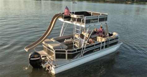 used pontoon boats with upper deck and slide for sale pontoon boat upper deck with a slide attached what a