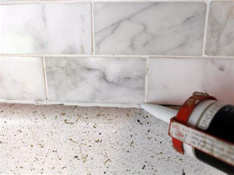 caulking kitchen backsplash how to install a marble tile backsplash hgtv