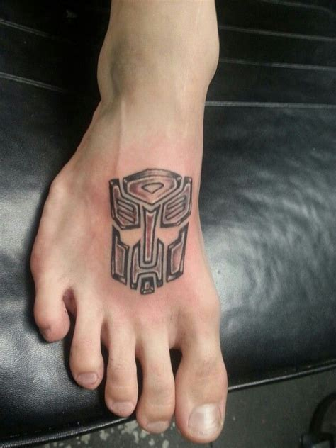 transformers tattoo tattoos by jud at 7 sins tattoo west