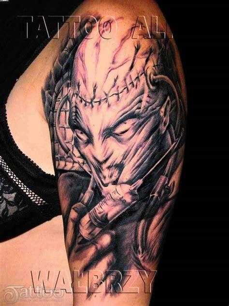 evil tattoo sleeve designs scary with syringe on arm tattooshunter