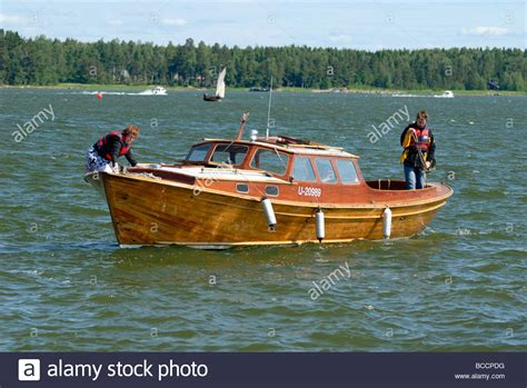 wooden boat motor traditional wooden motor boat leaving the marina in the