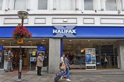 halifax bank lloyds bank to five halifax branches in surrey this