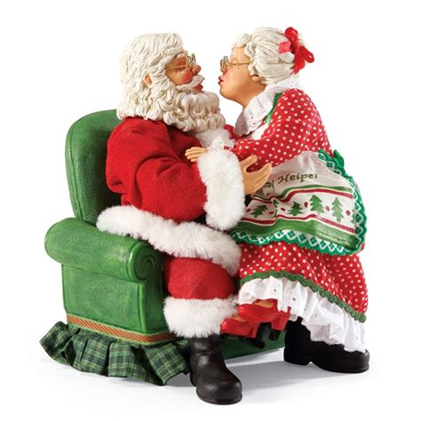 santa and mrs claus kissing possible dreams figurine