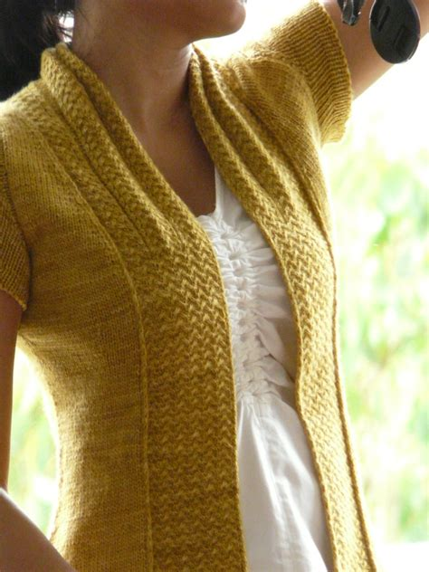knitting a sleeve these knitted cardigans are the way to update your