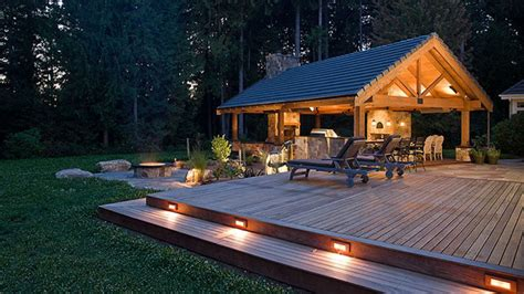 Outdoor fireplace with pizza oven, low patio voltage deck