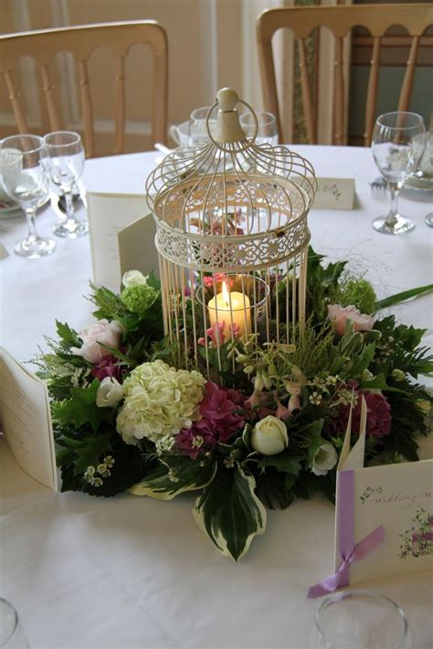 gold bird cage centerpiece with flower feather