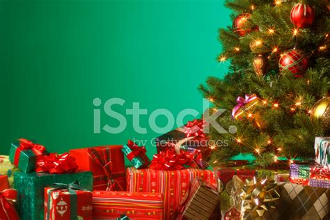 presents under the christmas tree stock photos
