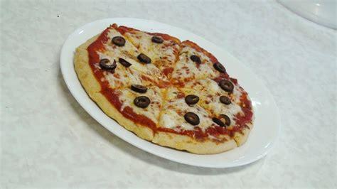 stovetop pizza no oven pizza stove top pizza video recipe by bhavna