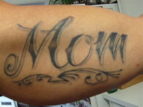 tribal mom tattoo black ink on bicep tattooshunt