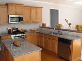 maple cabinets and a light grey granite countertop the