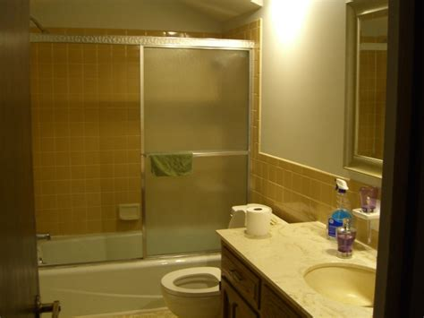 yellow tile bathroom paint colors remodelaholic bathroom makeover yellow gray color scheme