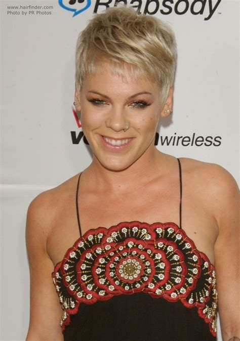 womans 1 inch haircut pink boyish short hairstyle with the ears and neck exposed