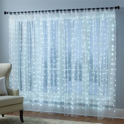 lighted curtains the holiday illuminated sheers hammacher schlemmer