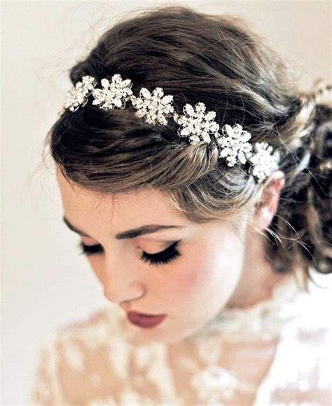 Bridal Hairstyles Low Bun With Flowers by S Low Bun With Swarovski Flower Headband