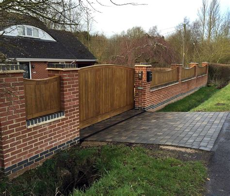 Walled And Gated Driveway Lush Garden Design Garden Walls And Fences