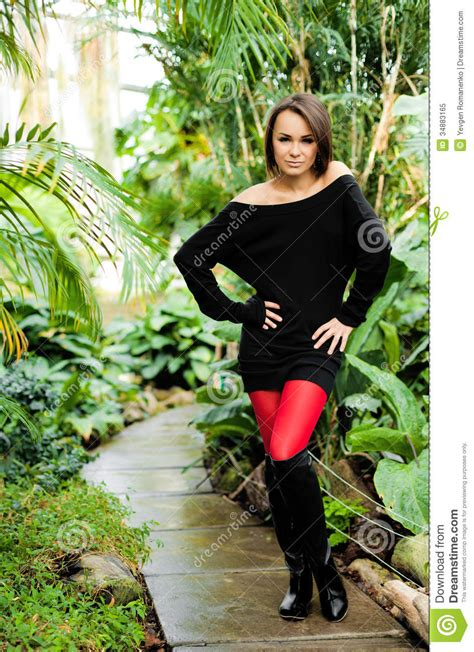 pretty woman wearing black dress red stockings stock image
