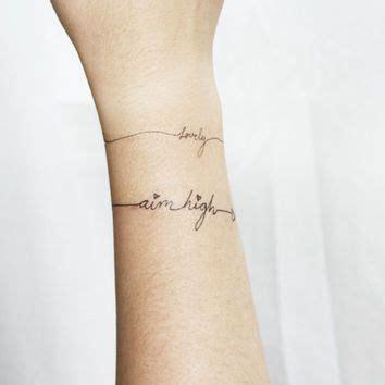 name bracelet tattoos on wrist bracelet tattoos with words search tat tat tat