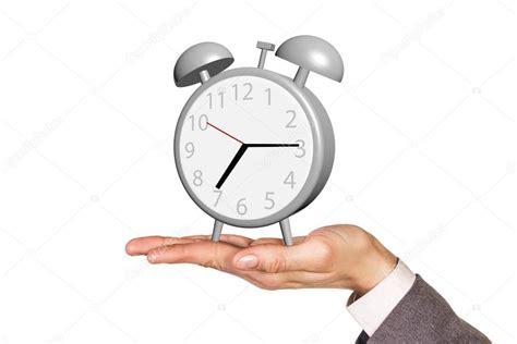 alarm clock stands   human palm stock photo  kotin