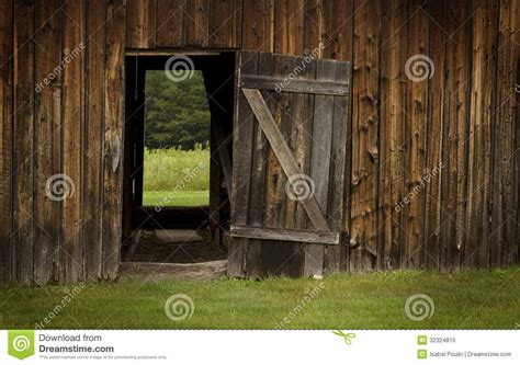 libro open the barn door barn door open on green landscape stock image image 32324815